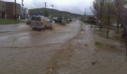 Several people are trapped in their vehicles on one of the main routes through town during the flood